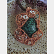 Copper and silver wire woven turquoise pendantCopper and silver wire woven turqu