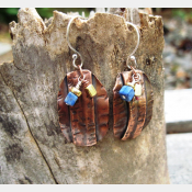 Primitive fold form tribal dangle earrings with bead accents