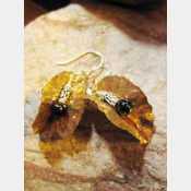 Tribal fold form bronze leaf earrings with sterling and black onyx