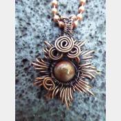 Copper corona pendant with multicolored stone center